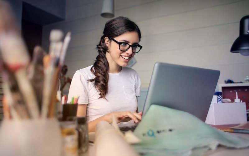 Digital marketing expert looking at laptop