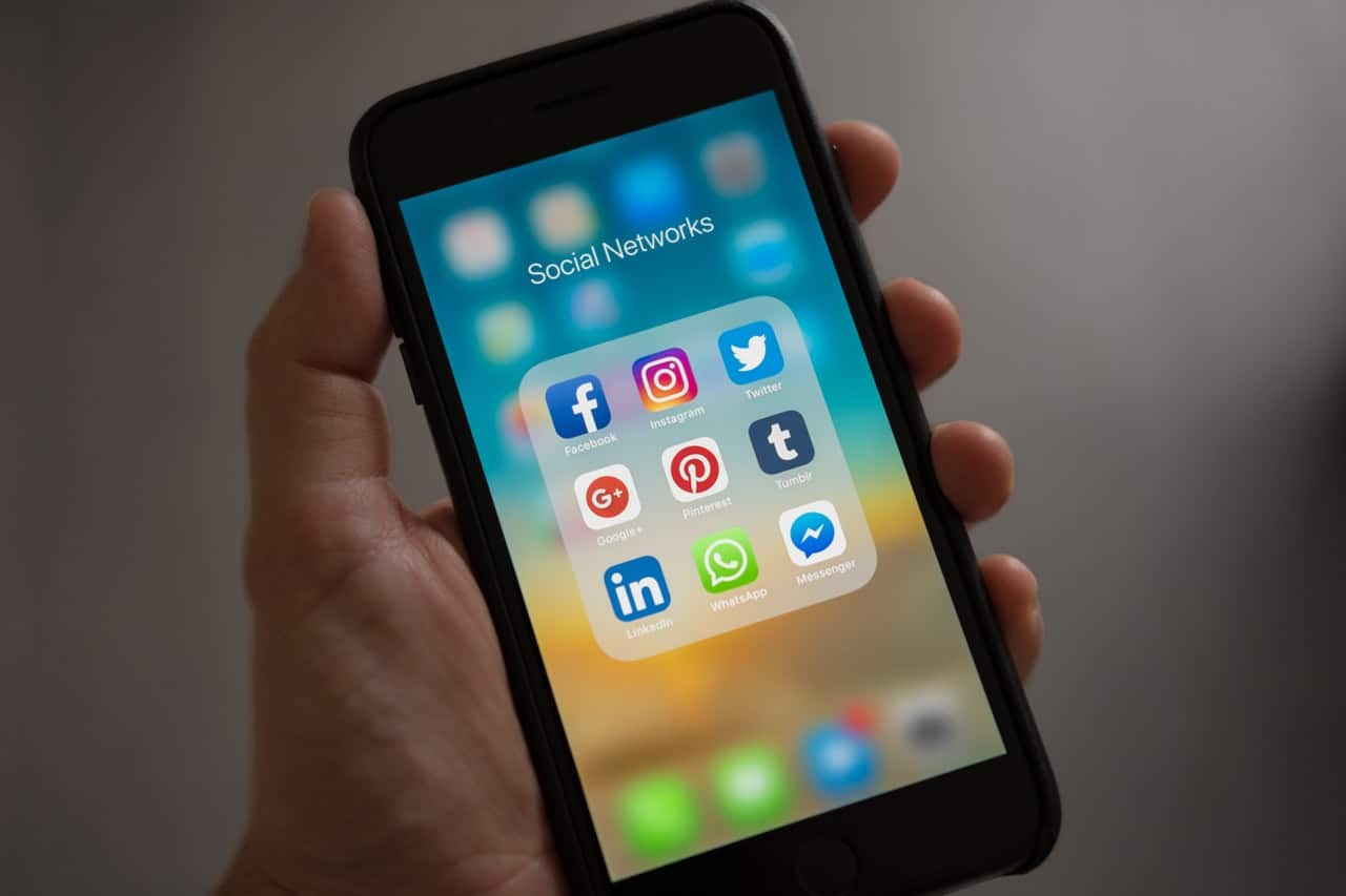 Apple iPhone with social media apps on home screen