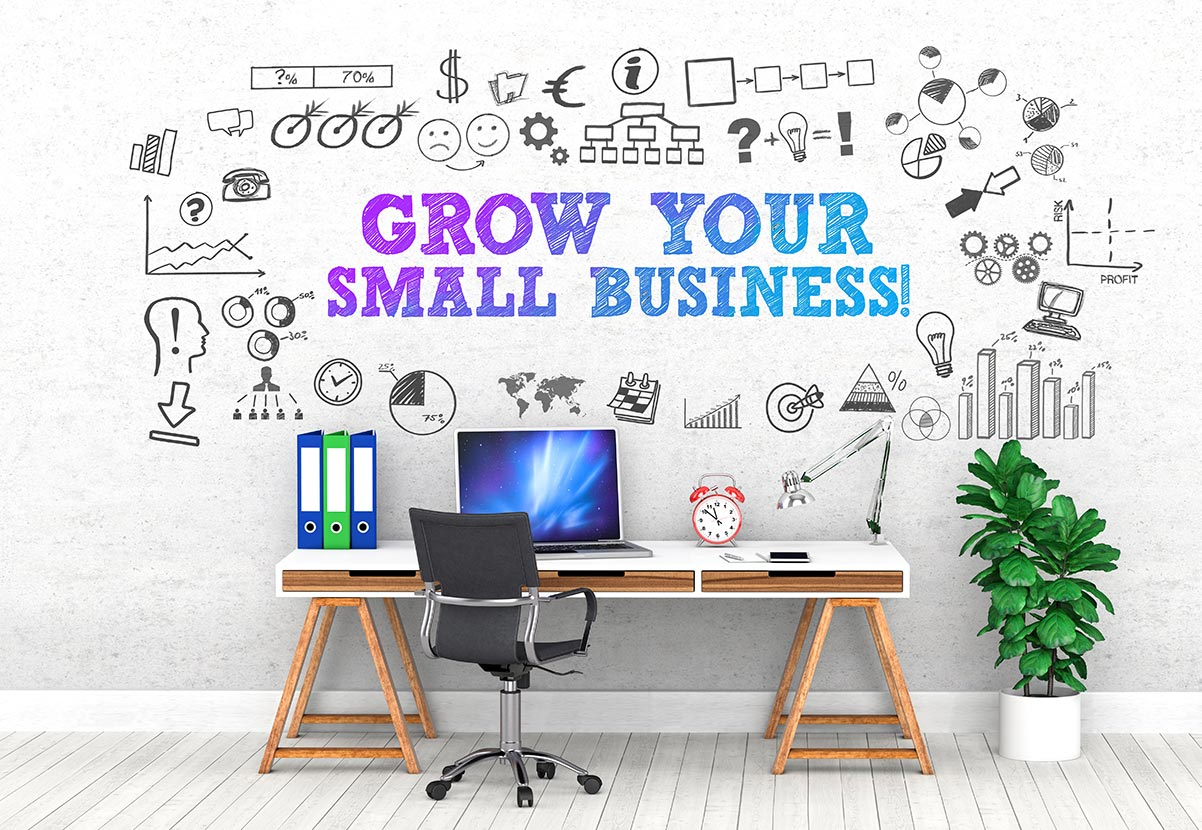 Grow your small business text written above creative desk