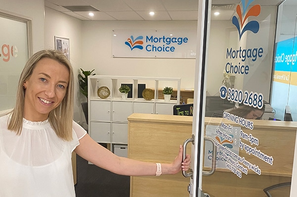 Kerry Wicks standing in front of Mortgage Choice Alex Hills
